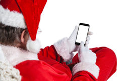 Le père noël à l'aide du téléphone portable Image libre de droits