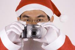 Le père noël asiatique avec l'appareil-photo Images libres de droits