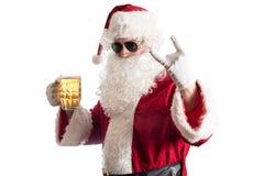 Le père noël avec de la bière Photos stock