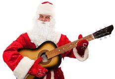 Le père noël avec une guitare dans des mes mains Photos libres de droits