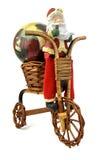 Le père noël dans la bicyclette Photos libres de droits