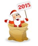 Le père noël dans un sac tient une bannière avec des numéros 2015 ans Photo libre de droits