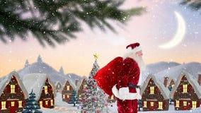 Le père noël devant les maisons décorées dans le paysage d'hiver combiné avec la neige en baisse banque de vidéos