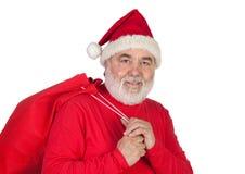 Le père noël drôle avec le sac rouge Image stock