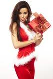 Le père noël et cadeau rouge de fixation sur le blanc Photos stock