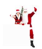 Le Père noël et Santa Giirl Image libre de droits