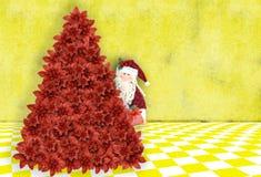 Le père noël laissant des cadeaux sous l'arbre de Noël Photos stock