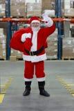Le père noël prêt pour Noël, ondulant photographie stock