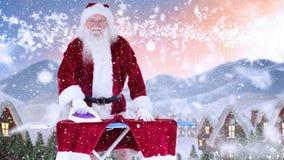 Le père noël repassant ses pantalons combinés avec la neige en baisse banque de vidéos