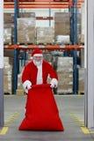 Le père noël se préparant à Noël Images libres de droits
