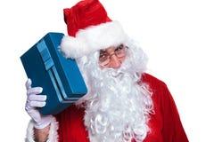 Le père noël SI écoutant un boîte-cadeau Image stock