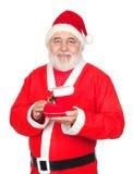 Le père noël souriant avec une gaine de Noël photo stock