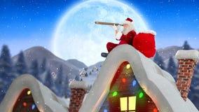 Le père noël sur le dessus de toit d'une maison décorée combinée avec la neige en baisse banque de vidéos