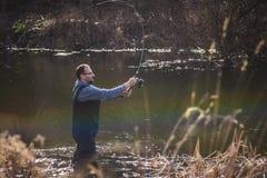 Le pêcheur jette un crochet Photo libre de droits