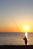 Le pêcheur reste à terre exterminant Photos stock