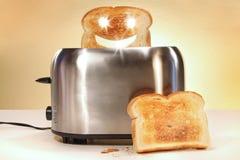 le pain découpe le grille-pain en tranches deux Image libre de droits