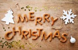 Le pain d'épice exprime le Joyeux Noël photos stock