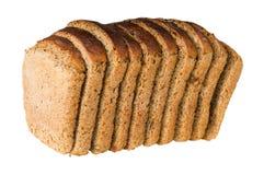 Le pain du pain avec le raisin sec a coupé par des parts Photographie stock libre de droits
