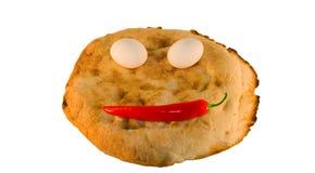 le pain eggs autour des légumes de sourire Photo stock