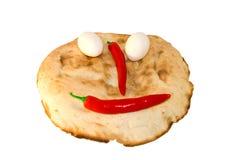 le pain eggs autour des légumes de sourire Photographie stock libre de droits