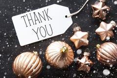 Le palle bronzee di Natale, i fiocchi di neve, testo vi ringraziano Fotografia Stock Libera da Diritti