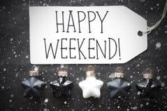 Le palle nere di Natale, fiocchi di neve, mandano un sms al fine settimana felice Fotografia Stock Libera da Diritti