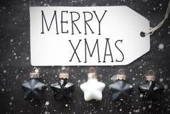 Le palle nere di Natale, fiocchi di neve, mandano un sms al natale allegro Immagine Stock