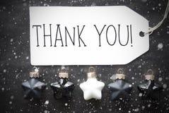 Le palle nere di Natale, i fiocchi di neve, testo vi ringraziano Fotografia Stock