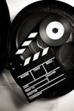 Le panneau de clapet de film sur le film de 35 millimètres tournoie Photos libres de droits