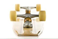 Le panneau en bois de patin desserrent en fonction sur le blanc Photographie stock libre de droits