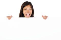 le panneau-réclame a étonné la femme Photos stock