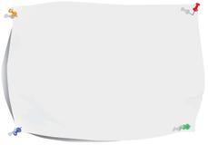 le papier bariolé goupille le blanc de feuille Photo stock