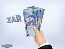 Le papier d'argent de couche-point de l'Afrique du Sud en main, encaissent en main Photo libre de droits