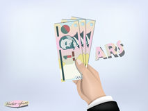 Le papier d'argent de peso de l'Argentine en main, encaissent en main Images stock