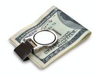 Le paquet de 100 dollars de billets de banque attachent avec l'agrafe d'argent Photographie stock
