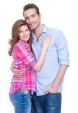 Le par i tillfälligt anseende i studio royaltyfri foto
