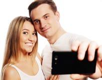 Le par med smartphonen Arkivbilder