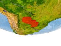 Le Paraguay en rouge sur le modèle de la terre Photos stock