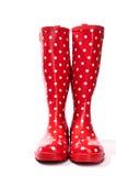 Le parement rouge et blanc de bottes de caoutchouc de point de polka expédie photographie stock