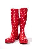 Le parement rouge et blanc de bottes de caoutchouc de point de polka expédie légèrement ouvert Image libre de droits