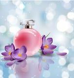 Le parfum rose du ` s de femmes de bouteille avec le ressort fleurit des crocus sur le fond brouillé Vecteur Photographie stock libre de droits