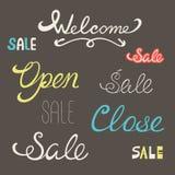 Le parole accolgono favorevolmente la fine aperta di vendita Fotografia Stock