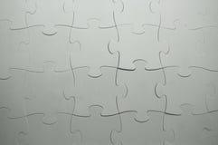 Le parti unite di un puzzle grigio Immagine Stock Libera da Diritti