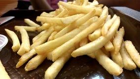 Le patate fritte si chiudono in su Immagine Stock Libera da Diritti