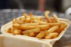 Le patatine fritte tolgono fuori il pranzo Fotografia Stock