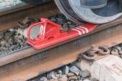 Le patin de frein ferroviaire ou pour garde sur les rails de la voiture ferroviaire Photo stock