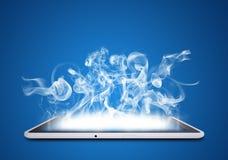 Le PC de Tablette émet la fumée blanche Images libres de droits