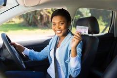 Le permis de conduire de femme Photographie stock