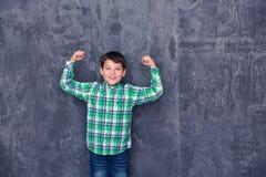 Le petit garçon aiment le surhomme Photo stock