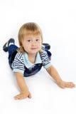 Le petit garçon dans des combinaisons Photos libres de droits